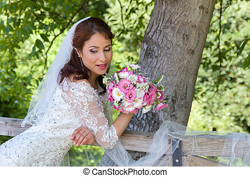 Dreamy bride in garden