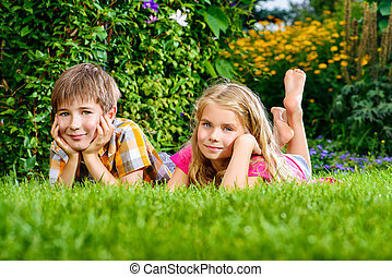 dreamy children - Happy summer holidays. Two smiling...