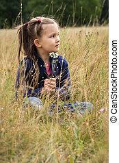 Dreamy girl in a field