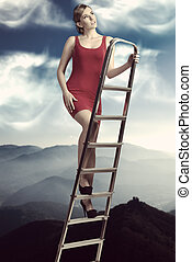 dreamy girl on ladder - dreamy woman with elegant red dress...