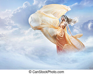 Dreamy image of a beautiful young lady in the clouds -...