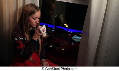 Dreamy pretty woman enjoying cup of coffee