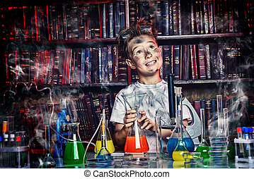 dreamy scientist - A boy doing experiments in the...