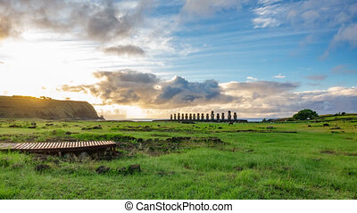 Dreamy sunrise over Ahu Tongariki Moai statues in Easter...