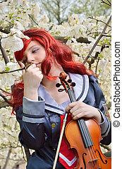 Dreamy teenage girl with a violin