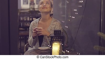 Dreamy woman drinking coffee - View through window of happy...