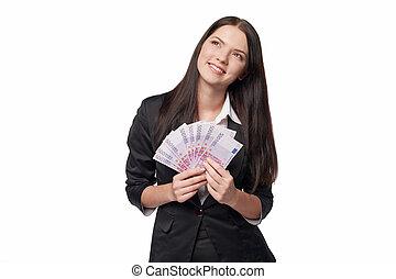 Dreamy woman holding euro money - Dreamy business woman ...