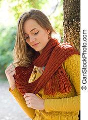 Dreamy young autumn fashion woman.