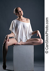 Dreamy young model posing in fashionable blouse