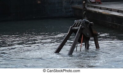 Dredge Bucket. Closeup. - Dredger and bucket working in the...
