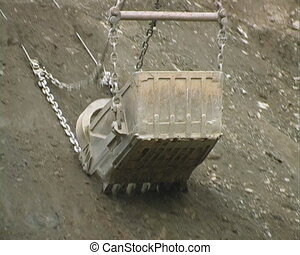 Dredge bucket. - Excavator at construction site.