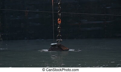 Dredge Bucket. - Dredger and bucket working in the Fraser...
