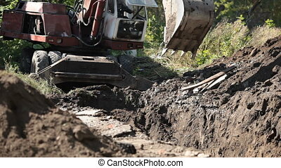 Dredge - Excavator digs the earth