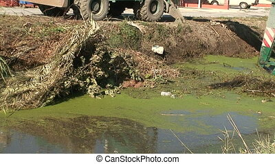 Dredging a canal - Removing silt and overgrown vegetation...