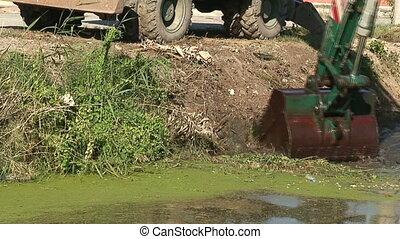 Dredging a canal