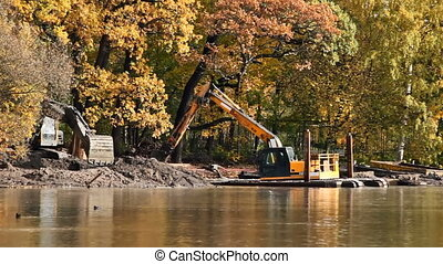 Dredging: a raising of a ground from a bottom on coast