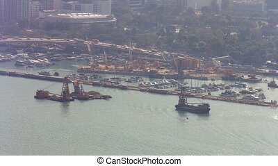Dredging Barges in the Channel and Urban Traffic in Hong...