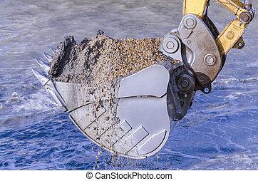 Dredging with an excavator - Excavator bucket dredging sand...