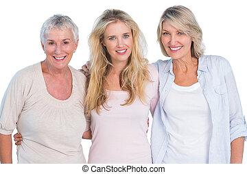 drei generationen, von, glückliche frauen, lächeln, kamera
