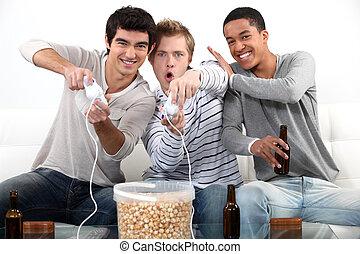 drei, mann, teenager, spielende , video, games.