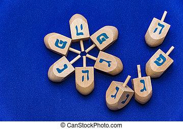 Dreidels for Hanukkah a blue background