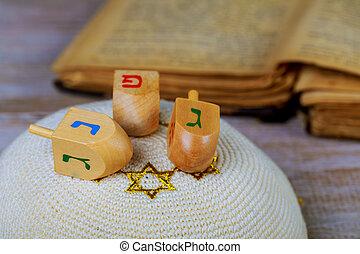 Dreidels for Hanukkah on wooden table