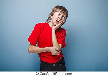 dreng, adolescent, europæisk, tilsynekomst, rummer, en, hånd på, hans, kind, wrink