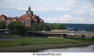 Dresden tram riding across bridge, river Elbe