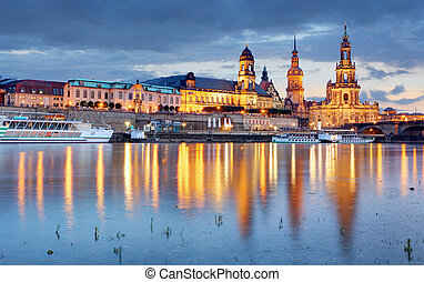 Dresden. Germany, during twilight blue hour with reflection of the city in Elbe River.
