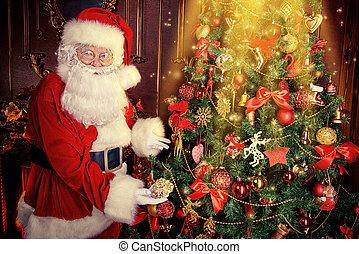 dress up tree - Santa Claus next to a beautiful ornate...
