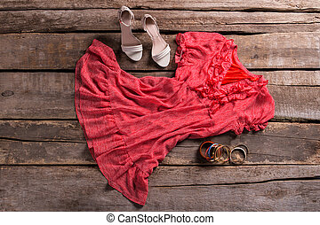 Dress with shoes and bracelets.