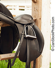 dressage saddle at the bracket. outdoor