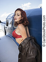 dressed in vintage pinup, Spanish civil war, red-haired woman