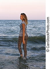 girl walks into the sea