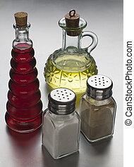 Dressing - Oil, vinegar, salt and pepper close up shoot