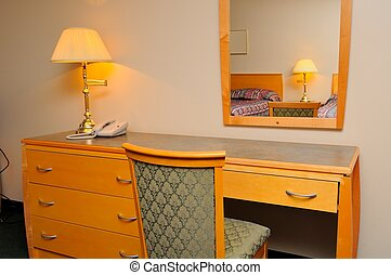 Generic dressing table and mirror in bedroom.