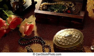 Dressing table with jewelry and precious stones and jewelry box. Camera slowly moves from left to right. 4k