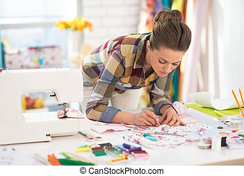 Dressmaker woman at work in studio