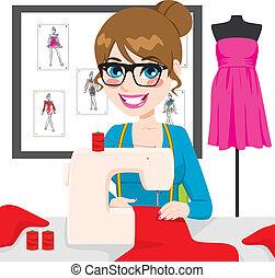 Dressmaker Woman Using Sewing Machine - Beautiful young...