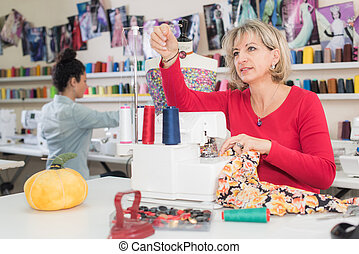 dressmaker working with an assistant in the background