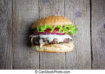 drewniany, cheeseburger, stół., apetyczny