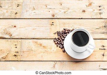 drewniany stół, kawa, biała filiżanka