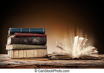drewniany stół, książki, stary