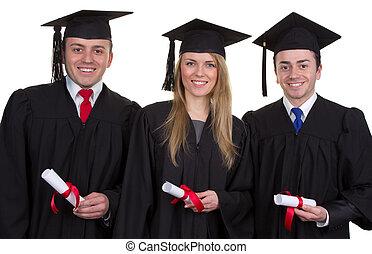 drie, afgestudeerdeen, met, rollen, het glimlachen, en, vrijstaand, op wit