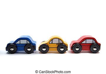 drie, houten speelgoed, auto's, in een rij