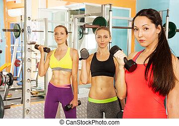 drie, jonge vrouwen, in, de, fitnessclub