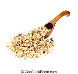 Dried Acacia flowers on the wooden spoon.