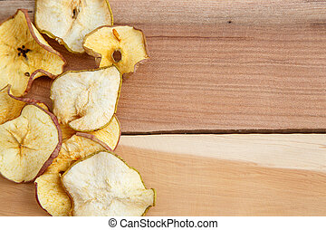 dried apples on wooden background. top view
