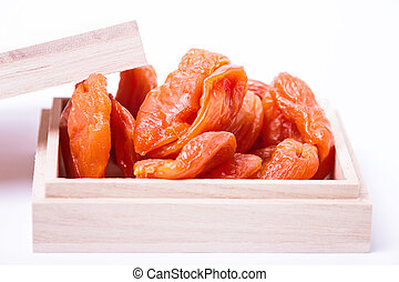 Dried apricots in a wooden box