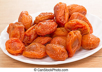 Dried apricots on a white plate